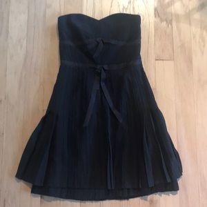 Black formal dress with pleats